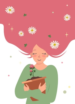 A young woman with pink hair hugs a pot of clover flowers.