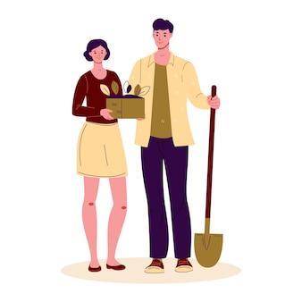 꽃 묘목을 가진 젊은 여자와 삽을 든 젊은 남자 농부 정원사