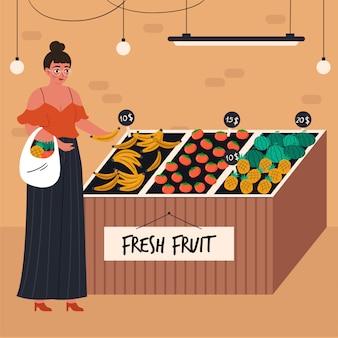 식료품가 게에서 음식을 구입하는 쇼핑 바구니와 젊은 여자