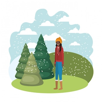 Young woman with winter clothes and winter pines