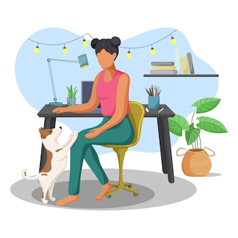 Young woman working at home with her cute dog.