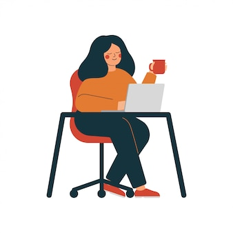 Young woman works at the laptop drinking tea. home office