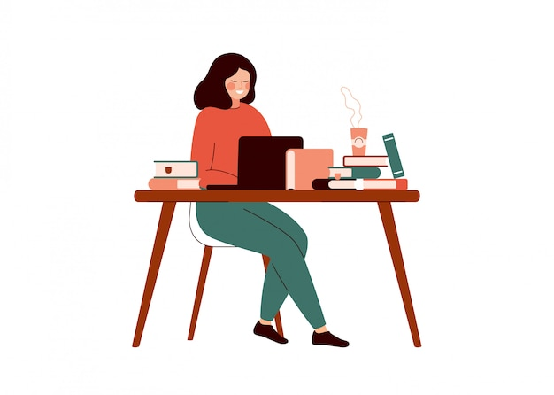Young woman works at the laptop surrounded with books.