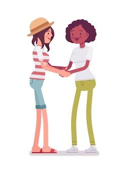 Young women handshaking