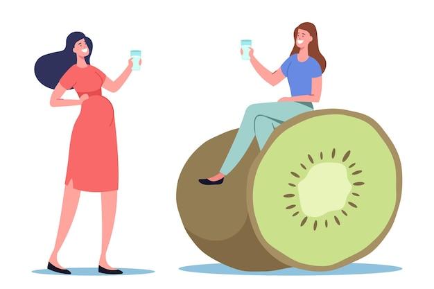 거대한 키위에 앉아 주입된 물을 마시는 젊은 여성