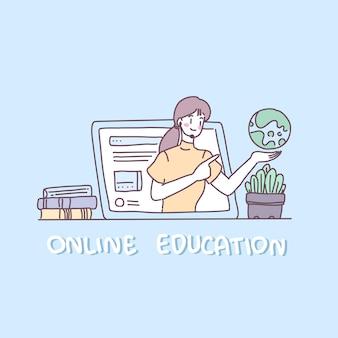 若い女性はノートパソコンをライブで使って本を教えています