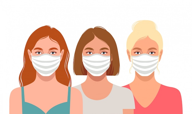 Молодые женщины в защитных масках