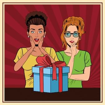Молодые женщины с подарочной коробкой поп-арт