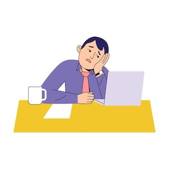 若い労働者は事務机で非常に退屈を感じる