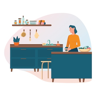 ゼロウェイストキッチンのコンセプト。再利用可能なコーヒーマグを持って台所のテーブルに立っている女性。料理や食事のための環境にやさしい物資。