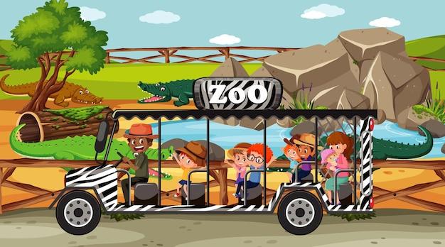 관광 차에 아이 들과 함께 동물원 장면