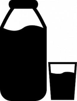 Milch-flasche und ein glas
