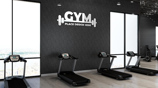 3d-fitnessstudio-logo-modell im fitnessbereich mit der schwarzen wand für sportler