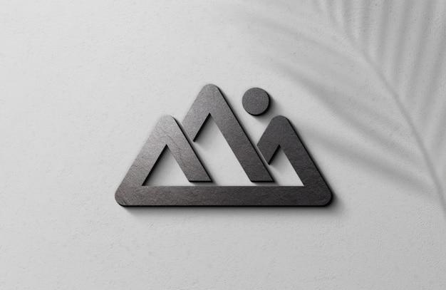 3d geprägtes logo-modell auf weißer oberflächenwand