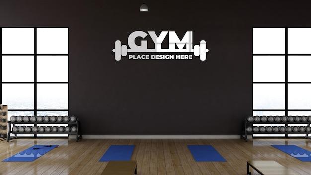 3d-render-fitnessraum mit realistischem wandlogo-modell