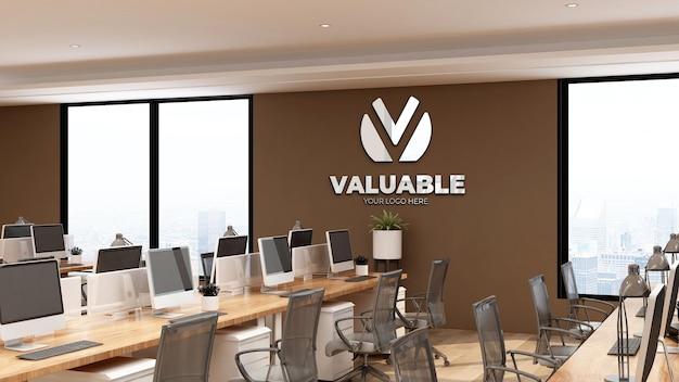 3d-wandlogo-modell in einem modernen büroarbeitsplatz mit brauner wand