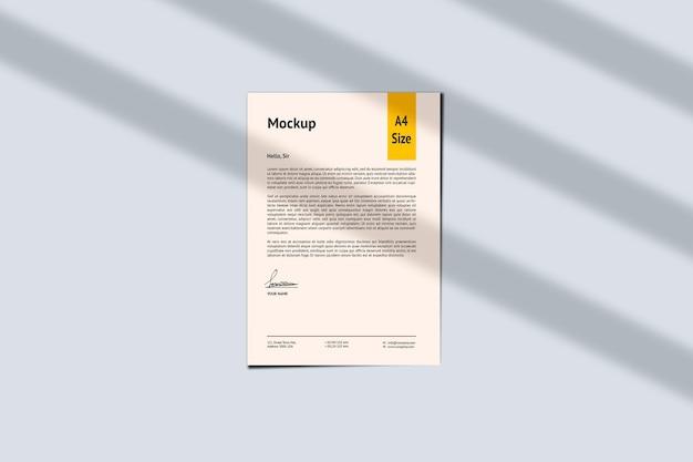 A4 papier- und schattenmodell-design-rendering isoliert
