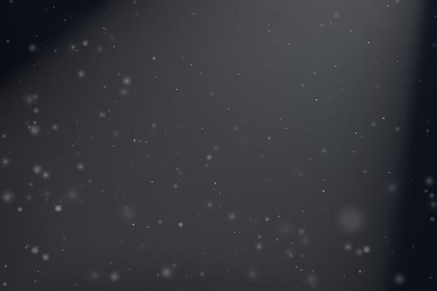 Abstrakter partikelstaubhintergrund mit dunklem licht