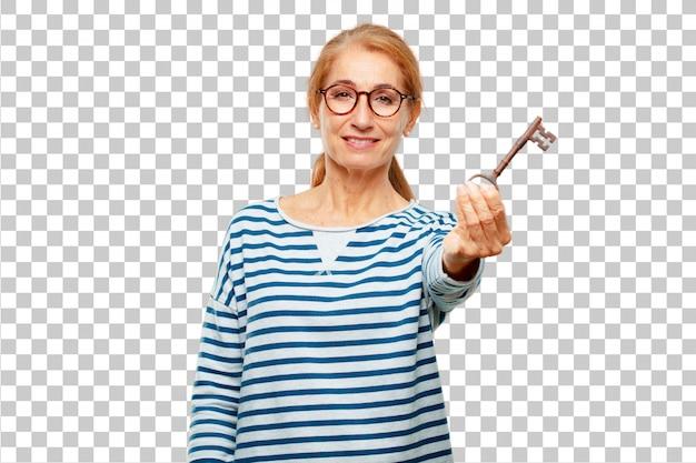 Ältere schöne frau mit einem weinleseschlüssel