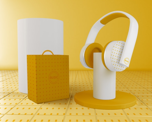 Anordnung mit gelbem und weißem kopfhörer