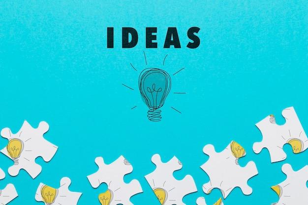 Anordnung mit puzzleteilen und glühlampezeichnung