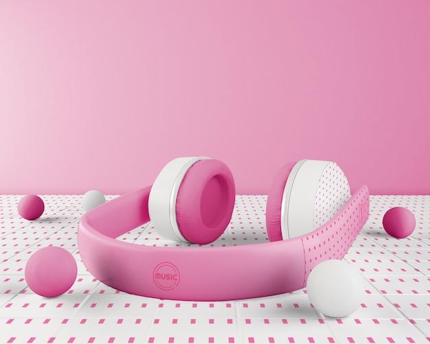 Anordnung mit rosa und weißem kopfhörer