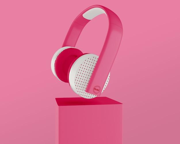 Anordnung mit rosafarbenem kopfhörer und hintergrund