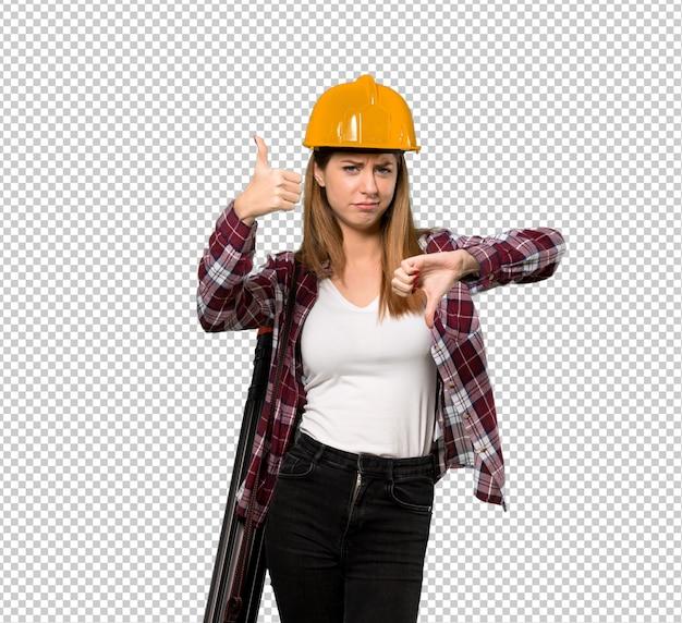 Architektenfrau, die gut-schlechtes zeichen macht. unentschieden zwischen ja oder nein