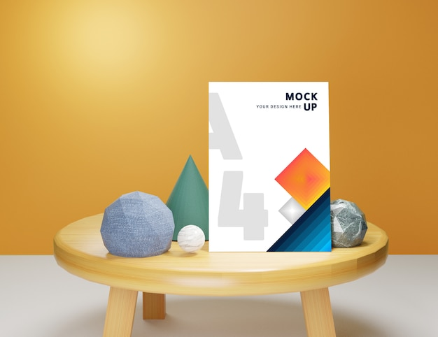 Bearbeitbares papiermodell im a4-format auf dem tisch mit abstrakten figuren