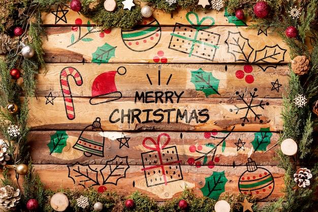 Beschriftungsmodell der frohen weihnachten auf hölzernem hintergrund