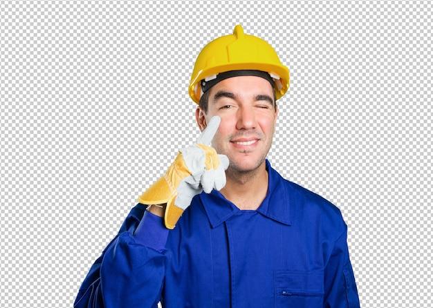 Besorgte arbeitskraft mit suchgeste auf weißem hintergrund