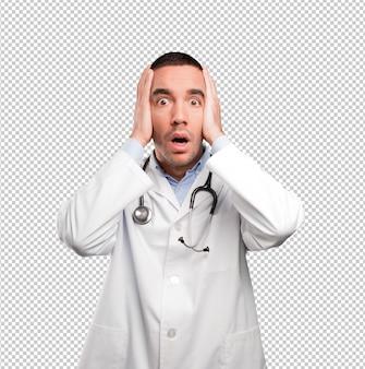 Besorgter junger doktor mit einer geste der depression