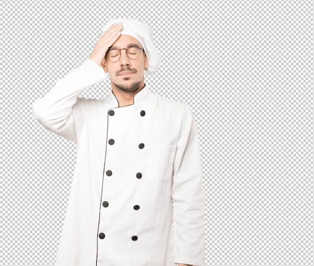 Besorgter junger koch mit einer stressgeste