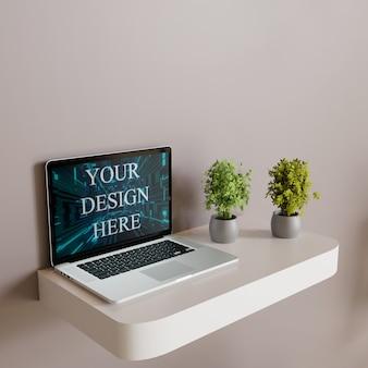 Bildschirm laptop-modell auf weiße wand schreibtisch mit pflanzen