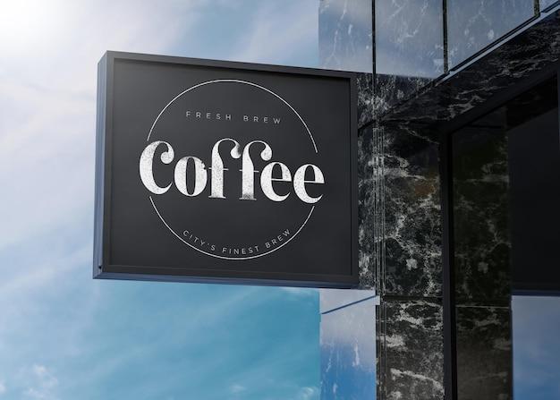 Black-box-zeichenfassade des logo-modells auf marmorgebäude