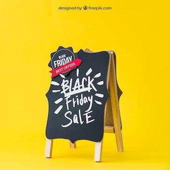 Black friday mockup mit dekorativen bord