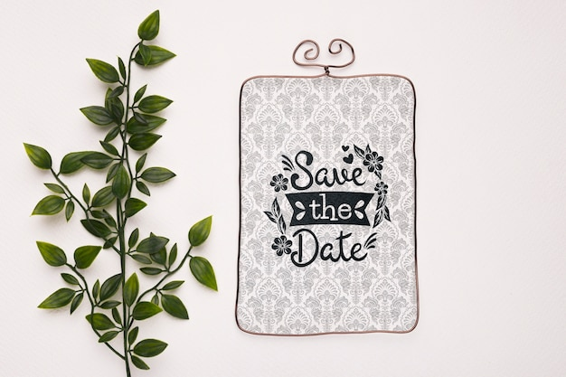 Blätter mit vintagem save the date-modell