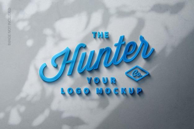 Blau leuchtendes logomodell mit schattenüberlagerung
