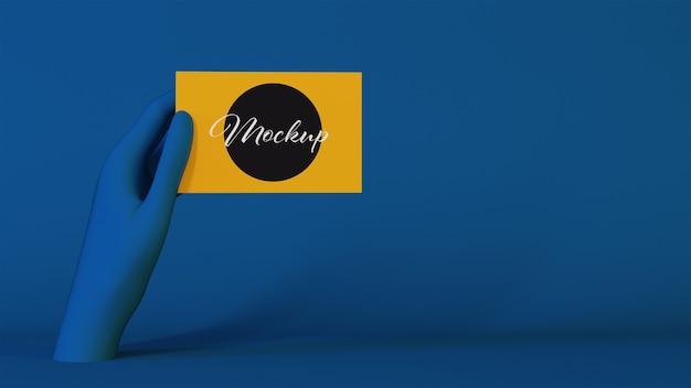 Blaue hand, die ein visitenkartenmodell zeigt
