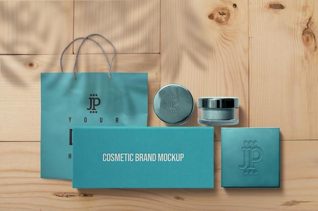 Blaues kosmetikglas und schachtelmodell