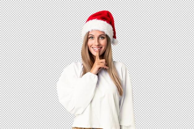 Blondes mädchen mit dem weihnachtshut, der ruhegeste tut