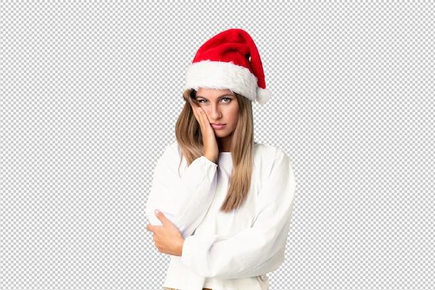 Blondes mädchen mit dem weihnachtshut unglücklich und frustriert