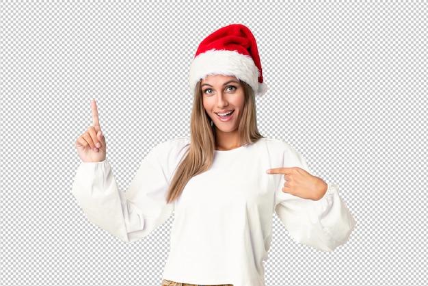 Blondes mädchen mit weihnachtshut mit überraschungsgesichtsausdruck