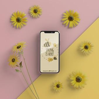 Blumenrahmen und telefon auf tabelle