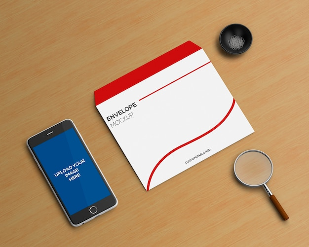 Briefpapierkonzept mit umschlag- und smartphonemodell