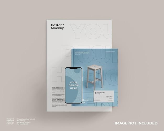 Buchcover-modell und poster mit einer visitenkarte und einem smartphone darauf