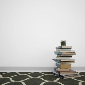 Bücher gestapelt auf dem boden neben der weißen wand mit copyspace