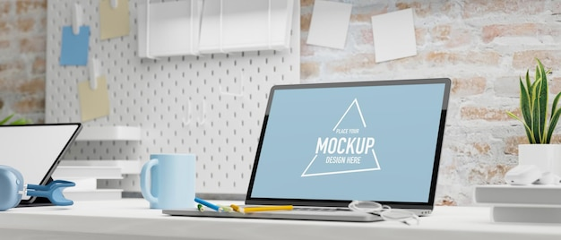 Büromaterial des laptop-modellbildschirms und pflanzentopf auf dem tisch 3d-rendering