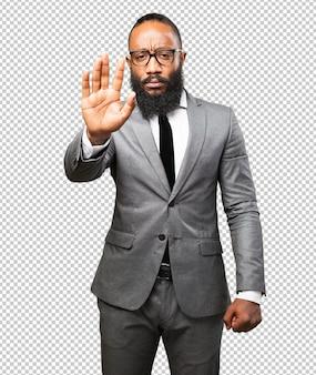 Business schwarzer mann stop geste