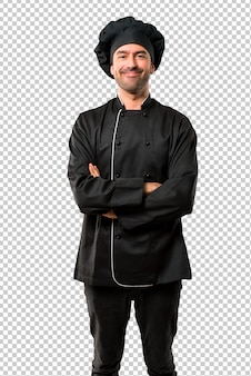 Chefmann in schwarzer uniform, die arme in frontstellung gekreuzt. zuversichtlicher ausdruck